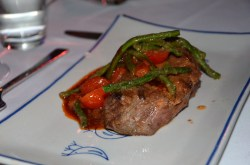 Yaki grilled beef served with a salad of haricot verts, cherry tomatoes and red onion