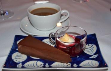 Chocolate truffle cake with seasonal compote and vanilla meringue